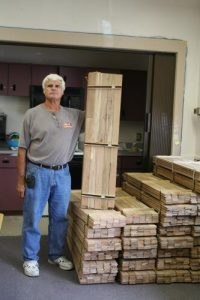 RHC - Bob Hughes volunteer holding milled wood